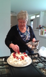 Avril decorates her pre-made Pavlova with fresh fruit.